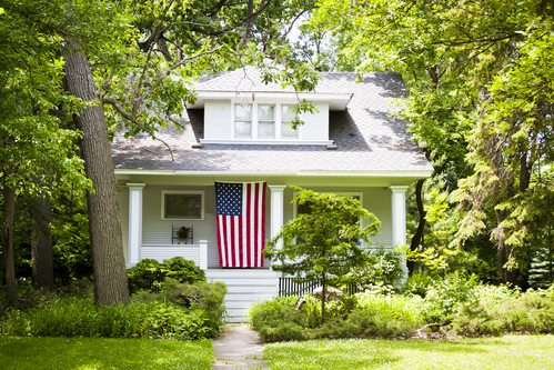 American Home with USA Flag Hanging on Porch