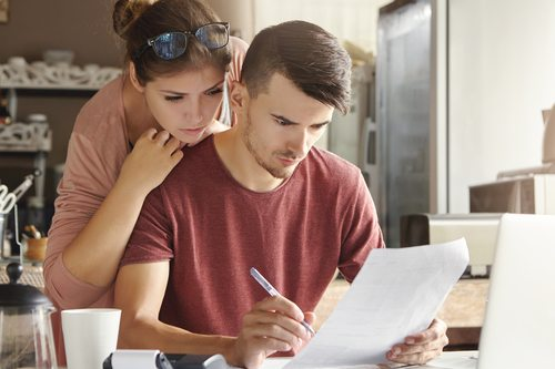 couple looking at important papers together