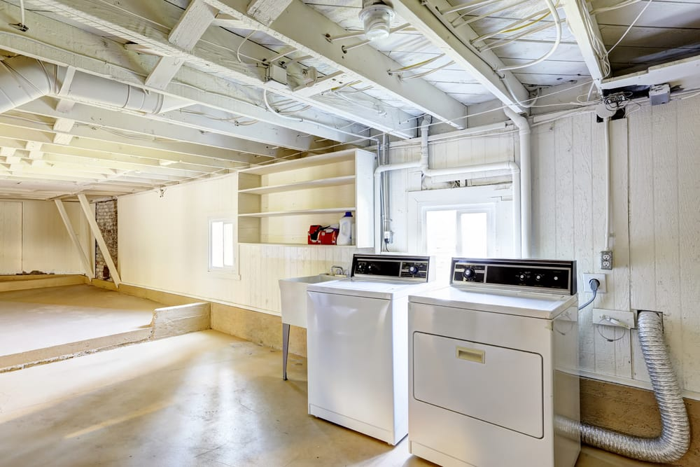 Spacious empty basement with laundry in american house