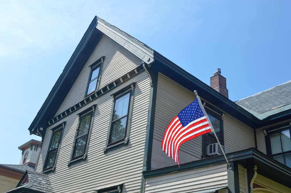 cropped photo of american flag on house