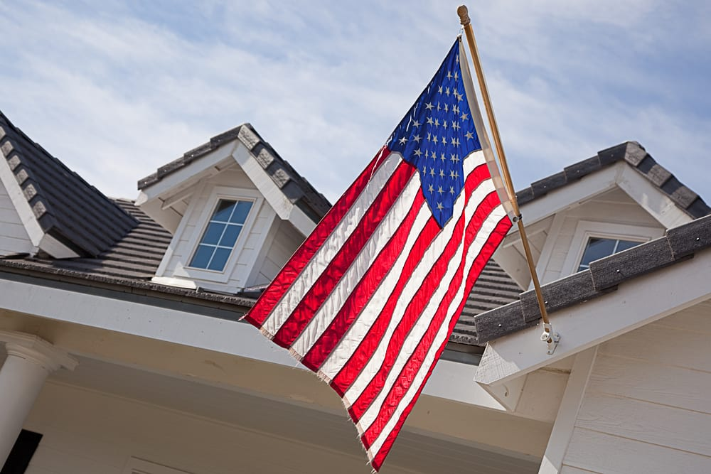 American flag hanging from home