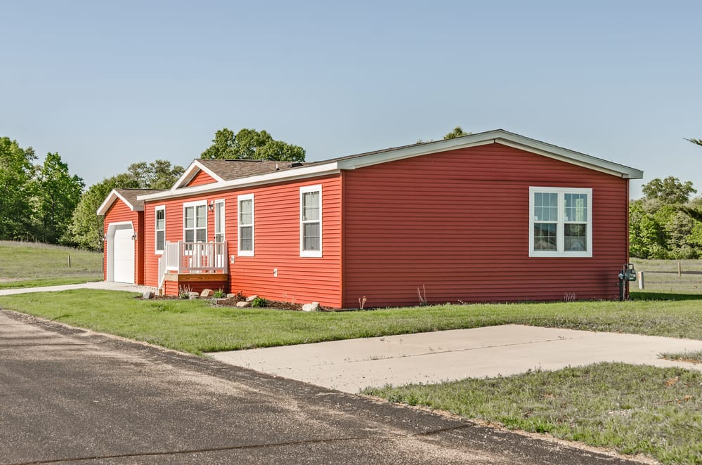 Manufactured home with red siding