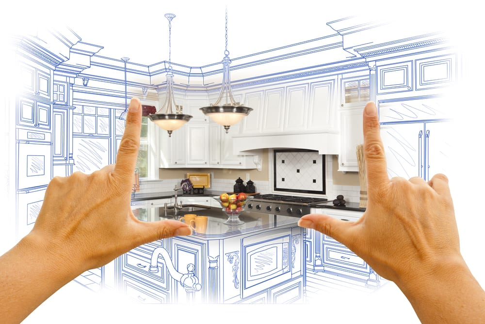 Hands held up to drawing, revealing rendering of remodeled kitchen